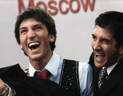 Evan Lysacek of the United States and his coach Ken Congemi react after winning bronze medal at the World Figure Skating Championships in Moscow.